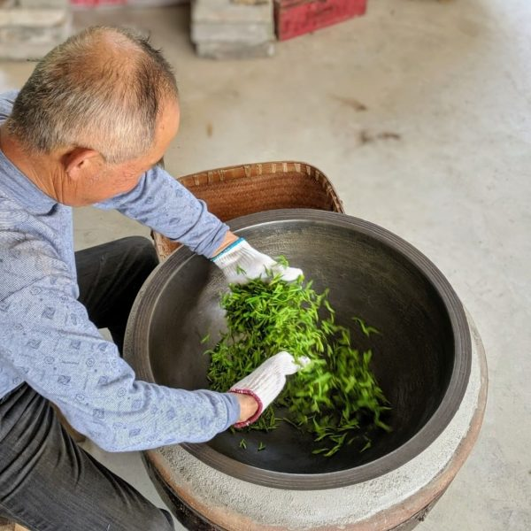 Our Unloved & Wild green tea is hand roasted. Here Mr. Cheng roasting it