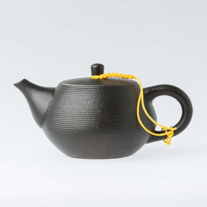 Black tea pot from the side